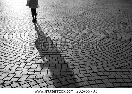 Textured background with the shadow of black and white images - stock photo