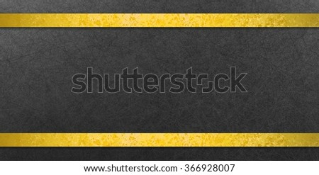 textured black background with gold foil ribbon - stock photo
