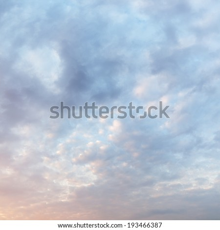 textured cloudy sky during sunrise - stock photo