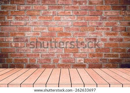 textured grey brick and stone wall with warm brown wooden floor inside old neglected and deserted interior, masonry and carpentry brickwork concept - stock photo