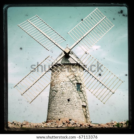 textured image of an old windmill - stock photo