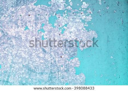 Textured industrial grunge background - light turquoise peeling paint on the old rough metallic surface  - stock photo