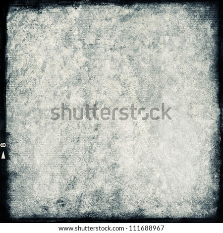 textured medium format filmstrip with grain textured and grunge border - stock photo