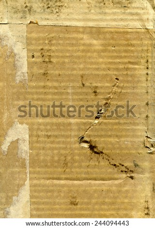 Textured obsolete damaged dirty cardboard with natural fiber parts - stock photo