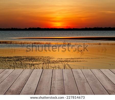 textured of wood terrace and beautiful dusky sky  - stock photo