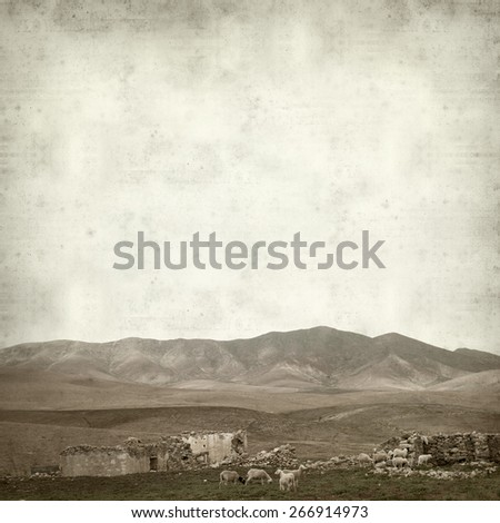 textured old paper background with landscape of Fuerteventura - stock photo