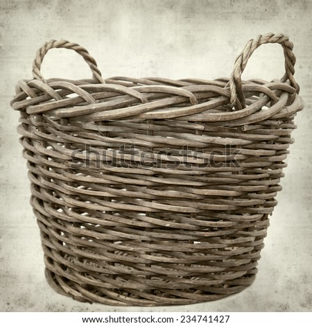 textured old paper background with large harvest basket - stock photo