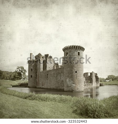 textured old paper background with Moated Caerlaverock Castle, Scotland - stock photo