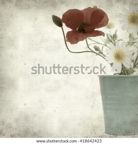 textured old paper background with simple posy of daisies and poppy - stock photo