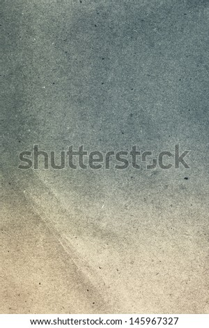 Textured recycled old shabby   paper dark coloedr. Useful as background. - stock photo