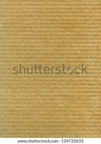 Textured recycled striped cardboard with natural fiber parts - stock photo