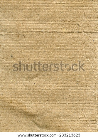 Textured recycled striped paper with natural fiber parts - stock photo