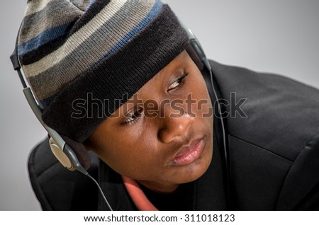 Thai-African American boy happy listening music - stock photo