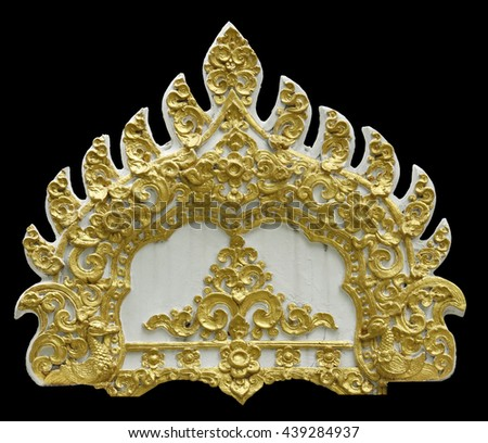 Thai ancient white plaster stucco decorative gate in front of thai temple. Isolated on black background. - stock photo