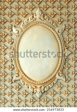 Thai art frame made cement wall in temple, Thailand - stock photo