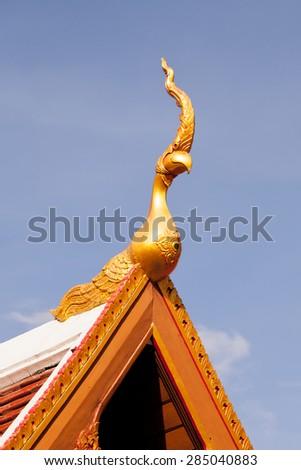 Thai art on roof Church at Thai temple. - stock photo