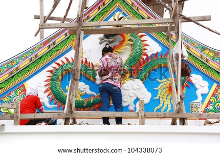 Thai art on the walls. - stock photo