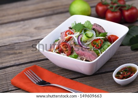 Thai beef salad with vermicelli noodles - stock photo
