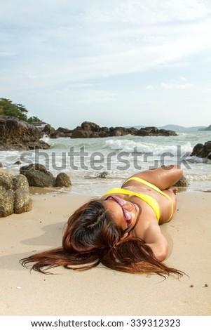 Thai bikini model on the beach - stock photo