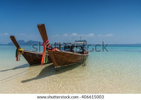 Thai boat longtail boat on the sea beach, Thailand, Koh rok Andaman - stock photo