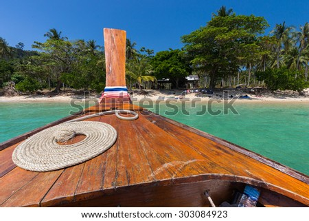 Thai boat with perfect rope coil in the Koh Ngai island near Ko Lanta, Thailand - stock photo