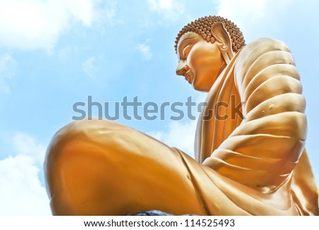 Thai Buddha Golden Statue against blue sky.This is traditional and generic style in Thailand. No any trademark or restrict matter in this photo. - stock photo