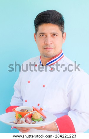 Thai chef serving food portrait - stock photo