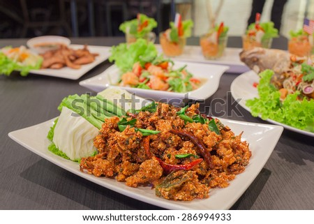 Thai cuisine spicy crispy pork salad, Larb with spicy salmon and grill pork - stock photo