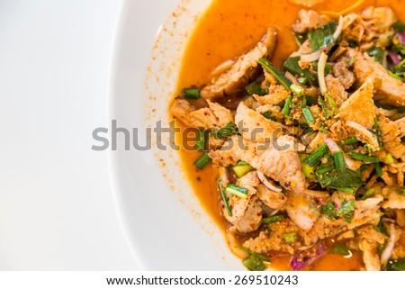 Thai cuisine spicy pork salad, Nam Tok Moo on white background - stock photo