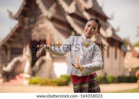 Thai dancing girl in action  with Lanna style cloths  - stock photo