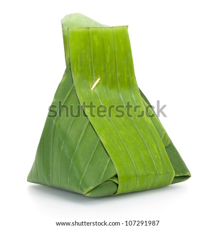 Thai dessert, Sticky rice with steamed custard, wrapped in banana leaves. - stock photo