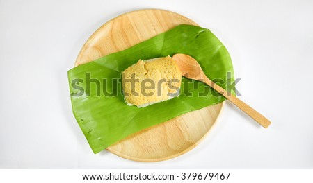 Thai dessert, Sticky rice with steamed egg custard, wrapped in banana - stock photo