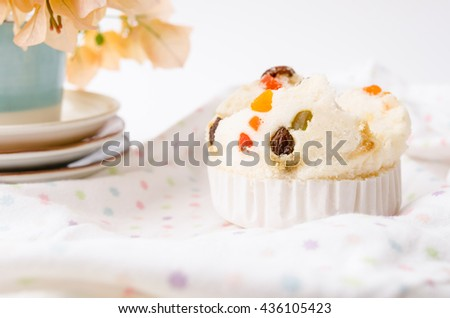 Thai dessert, Thai steamed cup cake or cotton wool cake with fabric background - stock photo