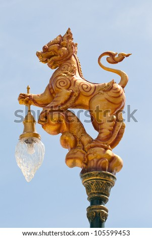 Thai fairytale lion mean strong and protect. Most Thai fairytale lion are decorate in temple. But this photo Thai lion are decorated for lamp. - stock photo