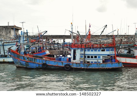 Thai Fishing Boats at a Harbour - stock photo