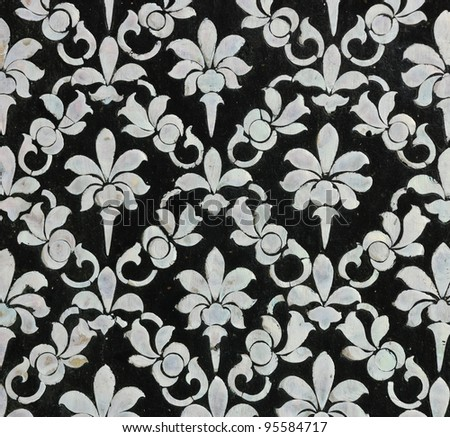Thai floral art with mother of pearl inlay on Buddhist temple's door - stock photo
