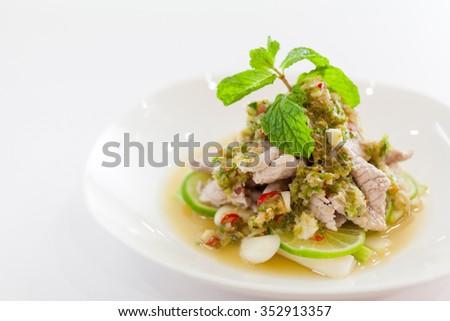 Thai food : Boiled Pork with Lime Garlic and Chili Sauce (Moo Ma nao). Shallow depth of field. - stock photo