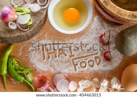 Thai food cooking ingredients and thai food handwritten - stock photo