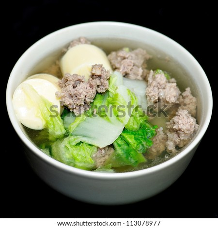 Thai food famous soup with green kitchen healthy eat food health dinner tasty table restaurant international onion garlic culture nutrition pork pepper  - stock photo