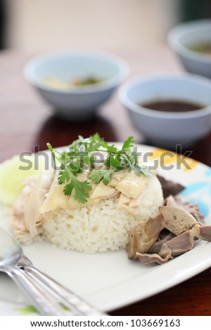 Thai food gourmet steamed chicken with rice , khao mun kai in wood background - stock photo