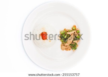 Thai food, kapao moo,  pork with basil, minced pork fried with chilli pepper and sweet basil. Close-up with shallow depth of field. angle/top view on white plate set - stock photo