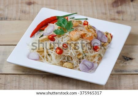 Thai food,mung bean noodle spicy salad,select focus - stock photo