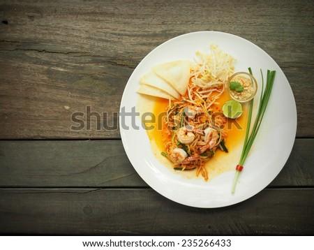 Thai Food : Padthai Thai noodle style on the wood desk - stock photo