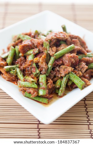 thai food,Pork fried lentils.Stir-fried pork with spicy lentils with herbs and spices as an ingredient. - stock photo