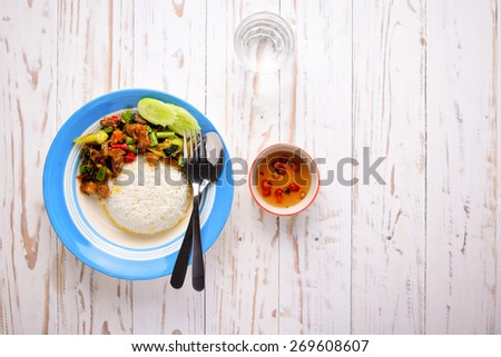 Thai food Rice and basil. Thai food, minced pork ,shrimp ,eggs fried with chilli pepper and sweet basil.Top view with copy space on right area. - stock photo