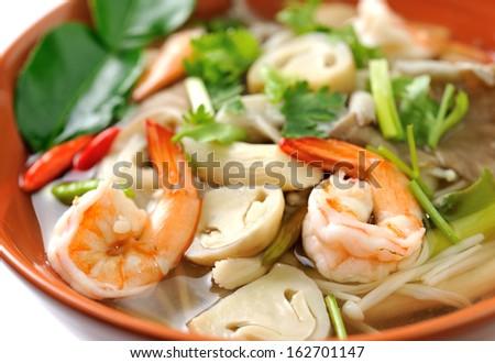 Thai Food Shrimp soup with mushrooms (Tom Yum Goong) - stock photo