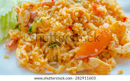 Thai Food, spicy lemon grass soup sea food fried rice - stock photo