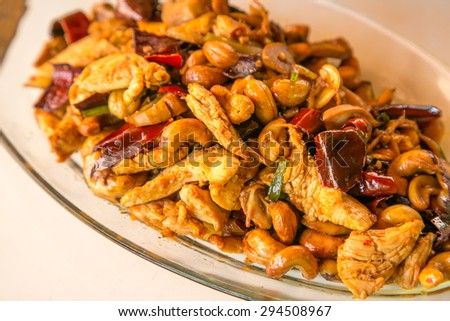 Thai food,stir fired chicken with cashew nuts a famous thai dish. - stock photo