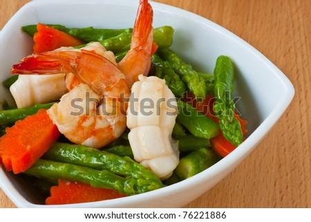Thai food, Stir-fried asparagus with seafood - stock photo