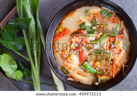 """Thai food """"Tom Yam Koong"""" (a classic spicy lemongrass and shrimp soup) - stock photo"""